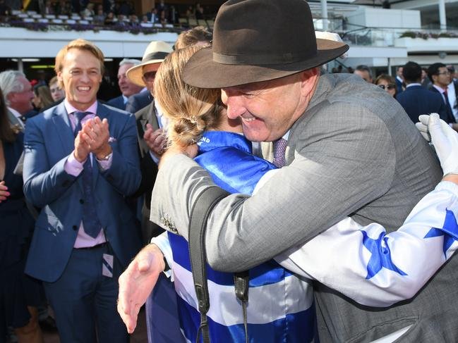 David Hayes hugs Jamie Kah after riding Harlem to victory in this year's Australian Cup.