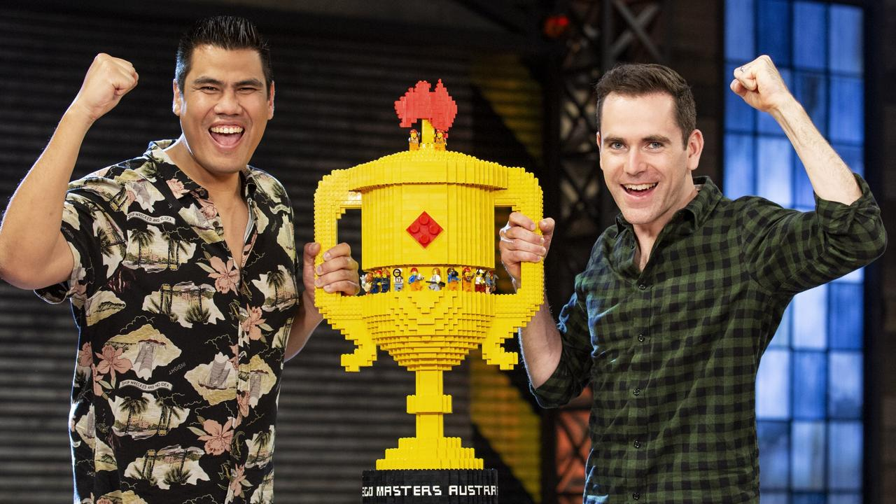 Lego Masters grand finale winners Henry Pinto and Cade Fletcher with their Lego trophy. Picture: Supplied
