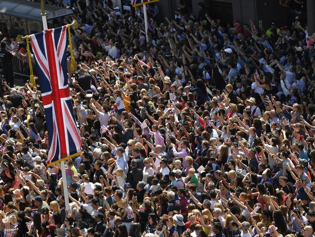 Fans cheer as Prince Harry, Duke of Sussex and the Duchess of Sussex ride a horse-drawn carriage after their wedding ceremony. Picture: Getty