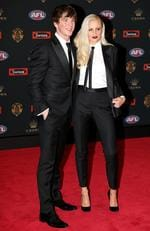 Liam Picken of the Western Bulldogs and Annie Nolan arrive at the 2016 Brownlow Medal Count.