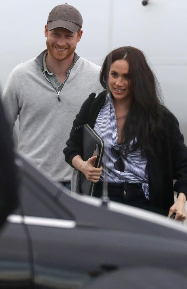 The couple were all smiles as they stepped off the plane. Picture: Backgrid