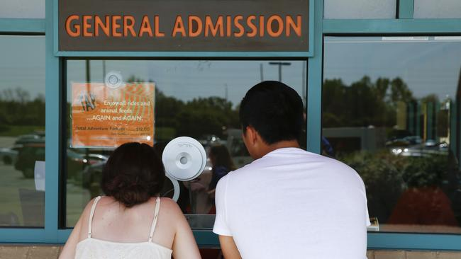 Visitors to the Indianapolis Zoo purchase tickets. Picture: Michael Conroy/AP