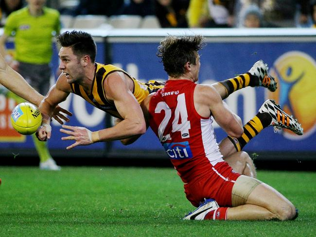 Hawthorn's Jack Gunston gets tackled by Dane Rampe. Picture: Colleen Petch