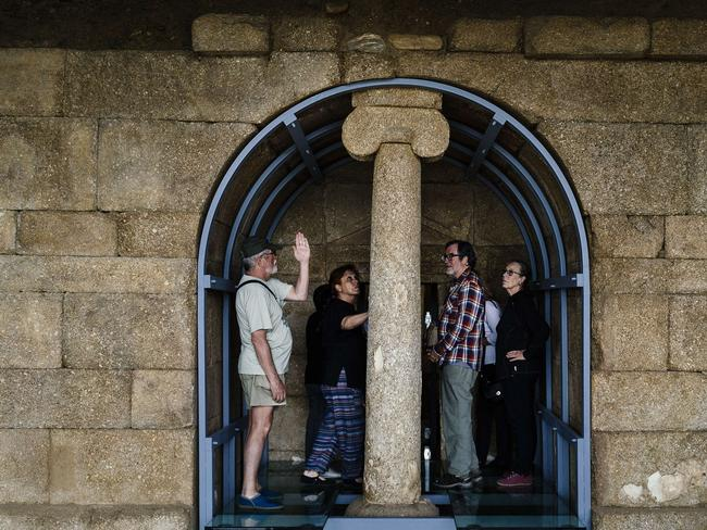 Tourists examine the Thracian tomb of Shushmanets.