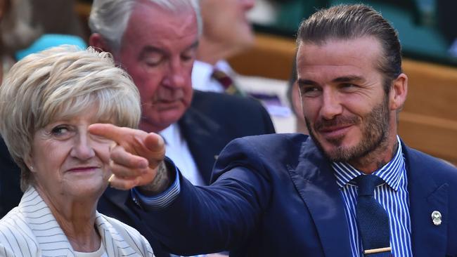 Former England footballer David Beckham (R).