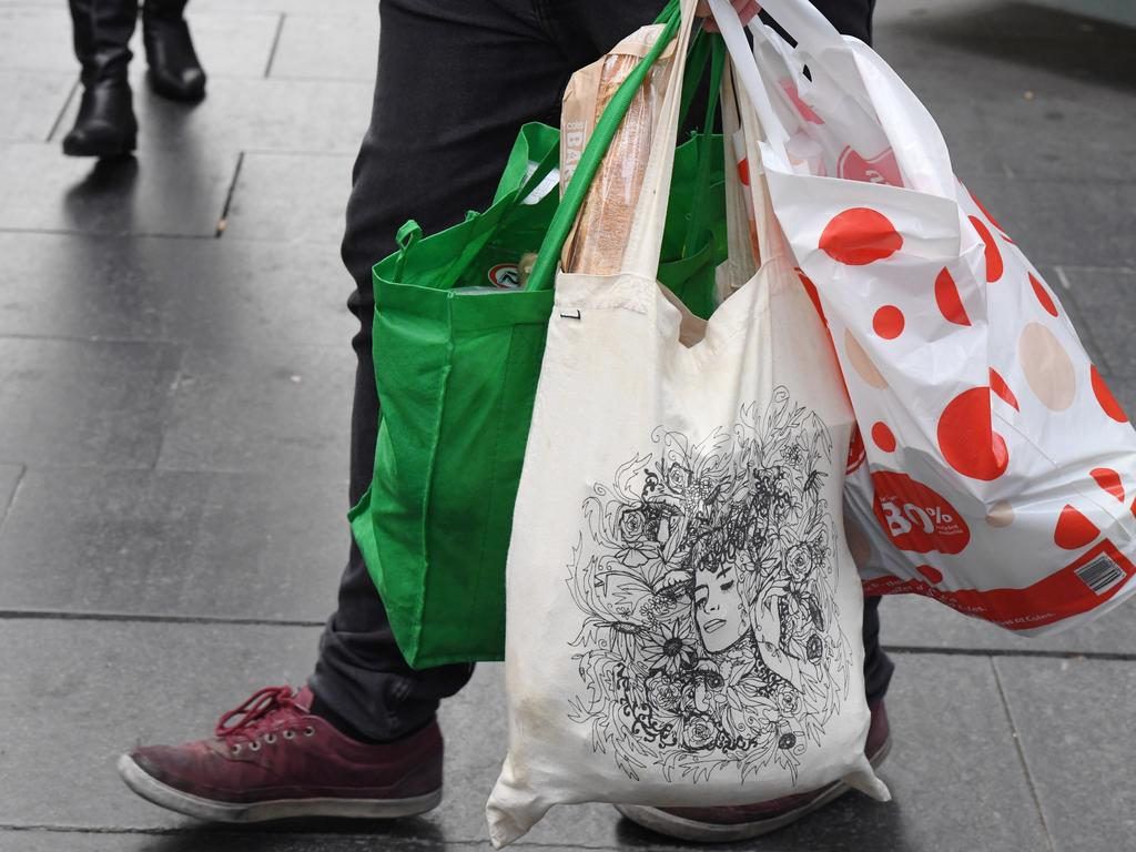 Coles and Woolworths both banned single-use plastic bags last year. Picture: AAP Image/Peter RAE.