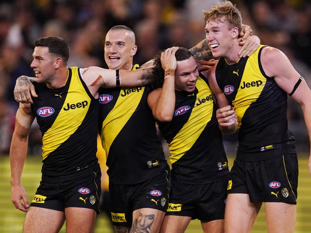 Jack Graham, Dustin Martin, Daniel Rioli and Tom Lynch of the Tigers celebrate the win during the First Preliminary Final match between the Richmond Tigers and the Geelong Cats in Week 3 of the AFL Finals Series at the MCG in Melbourne, Friday, September 20, 2019. (AAP Image/Michael Dodge) NO ARCHIVING, EDITORIAL USE ONLY