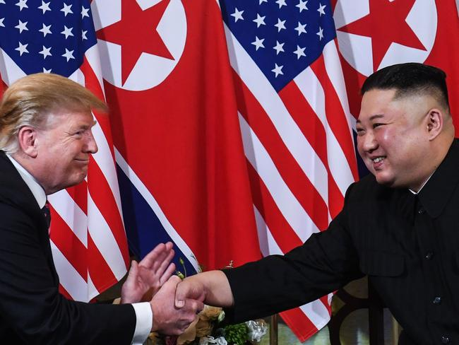 US President Donald Trump (L) shakes hands with North Korea's leader Kim Jong-un. Picture: AFP