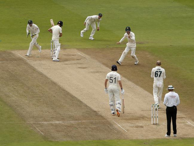 Moeen Ali is frozen at the crease after shouldering arms to a Nathan Lyon delivery that hit his stumps. (Photo by Ryan Pierse/Getty Images)