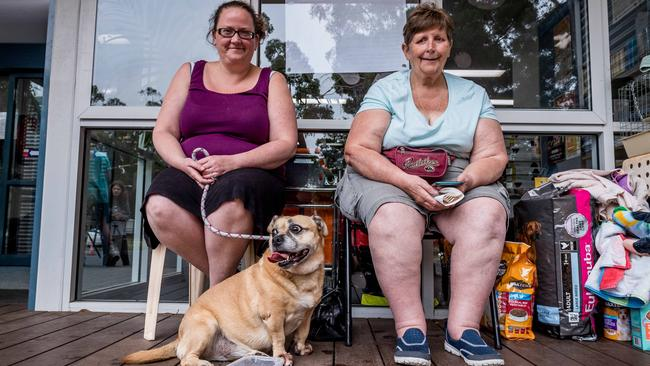 Kaye and Pam Shingler and their dog Molly take shelter at the Drouin relief centre. Picture: Jake Nowakowski