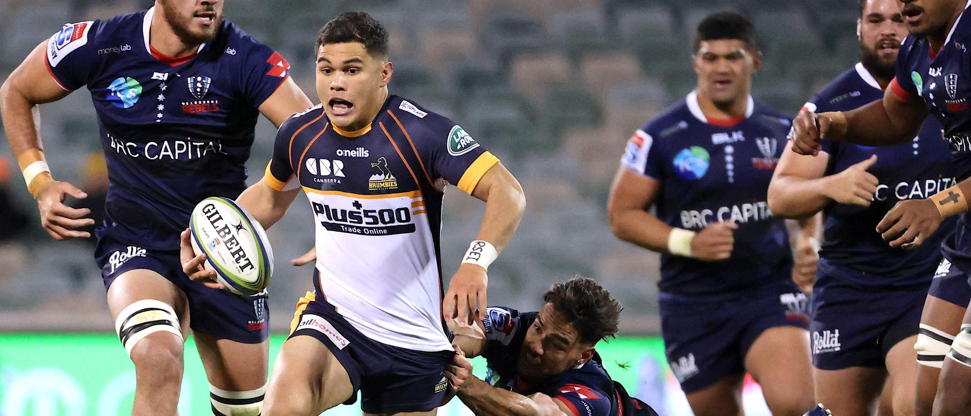 Noah Lolesio of the Brumbies runs with the ball during the Super Rugby match between the ACT Brumbies and Melbourne Rebels in Canberra on July 4, 2020. (Photo by DAVID GRAY / AFP) / IMAGE RESTRICTED TO EDITORIAL USE - STRICTLY NO COMMERCIAL USE