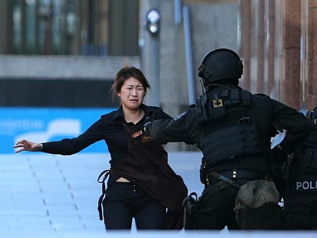 The emotion and relief was evident as the hostage met police. Picture: AP Photo/Rob Griffith