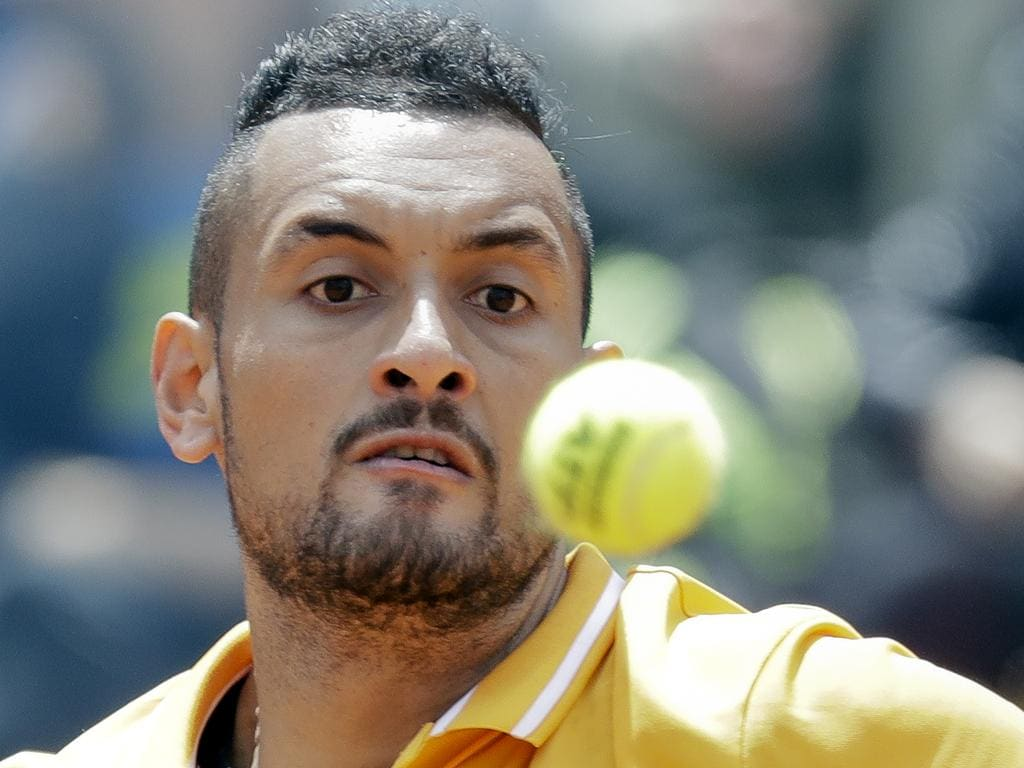 Nick Kyrgios of Australia returns the ball to Daniil Medvedev of Russia at the Italian Open tennis tournament, in Rome, Tuesday, May, 14, 2019. Kyrgios won 6-3, 3-6, 6-3. (AP Photo/Andrew Medichini)