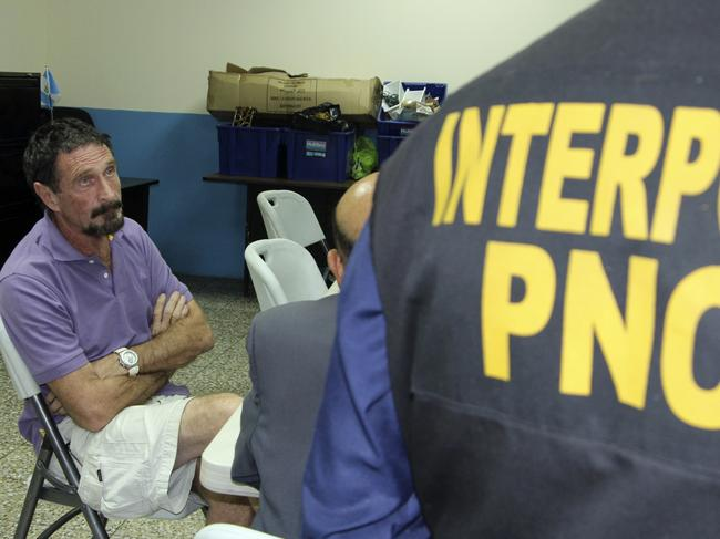 John McAfee is questioned by police in Guatemala in 2012. Picture: Getty Images