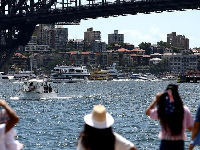 Spectators watch the Australia Day ferry race from the Barangaroo foreshore on Sydney Harbour today. Picture: Tim Hunter