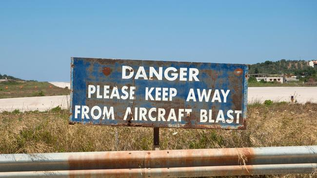 Warning signs do little to deter the plane spotters. Picture: Alamay