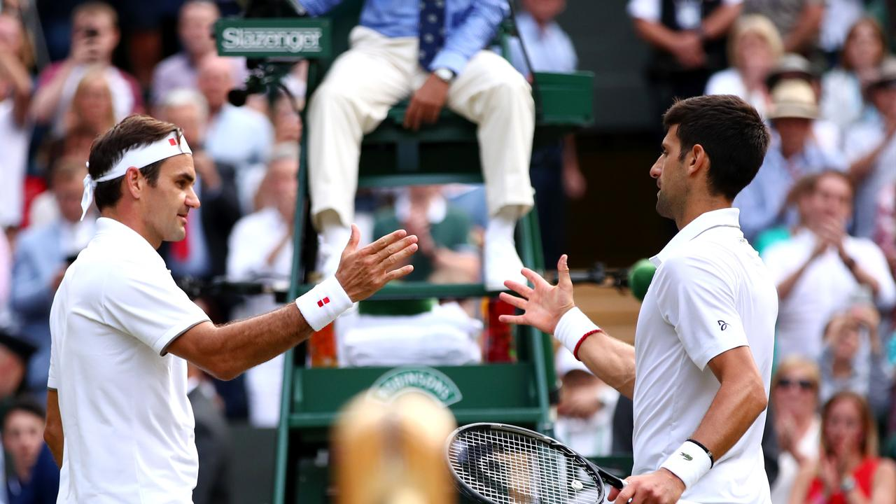 Novak Djokovic and Roger Federer played in last year's Wimbledon final. (Photo by Clive Brunskill/Getty Images)