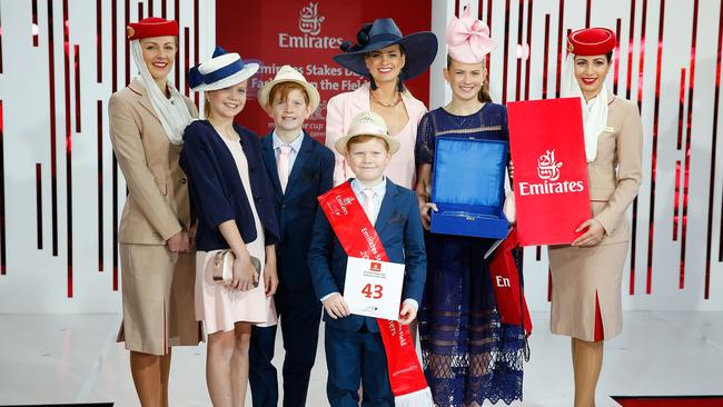 The Palmer family from Cohuna pose on Emirates Stakes Day at Flemington Racecourse.