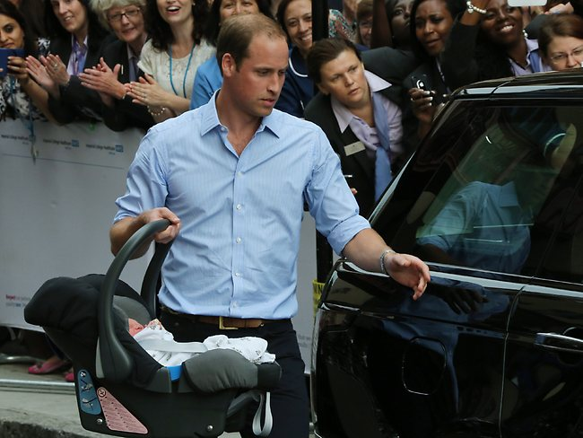Britain's Prince William, carries the Prince of Cambridge to the car as they leave St. Mary's Hospital exclusive Lindo Wing in London where the Duchess gave birth on Monday July 22. Photo: Joel Ryan/Invision/AP