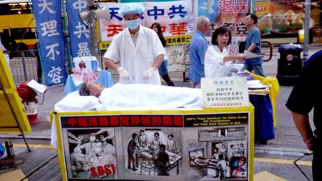 Falun Gong protesters simulate a prisoner organ-harvesting in Hong Kong. Picture: Cory Doctorow/Flickr