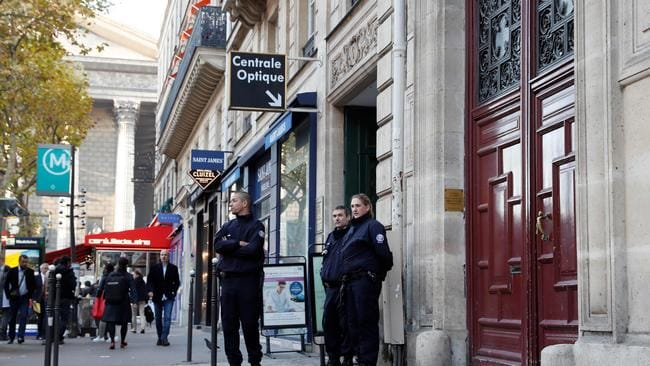 Police officers standing guard at the entrance of the hotel residence where Kim Kardashian was robbed at gunpoint by assailants disguised as police. Picture: AFP / Thomas Samson