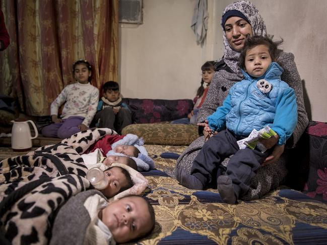 Mother of quadruplets Elham Ali, 33, in Deir ez Zor with her daughter Marah, 18 months, and babies from (left) Farah, Ataa, Sharoq and Abdullah. Picture: Ella Pellegrini