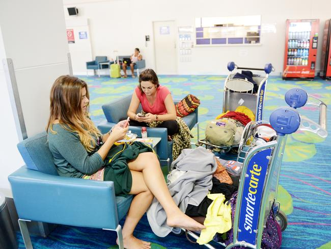 Delays could be coming to an end ... passengers inside Darwin Airport on Saturday. Picture: Elise Derwin