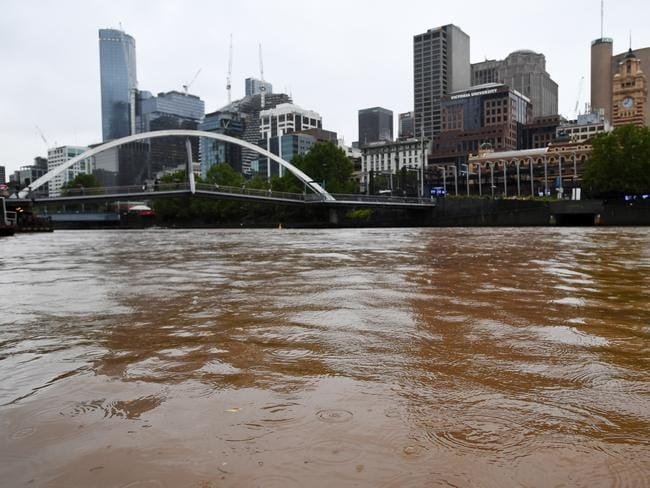 The river turned a dark brown. Picture: Erik Anderson/AAP