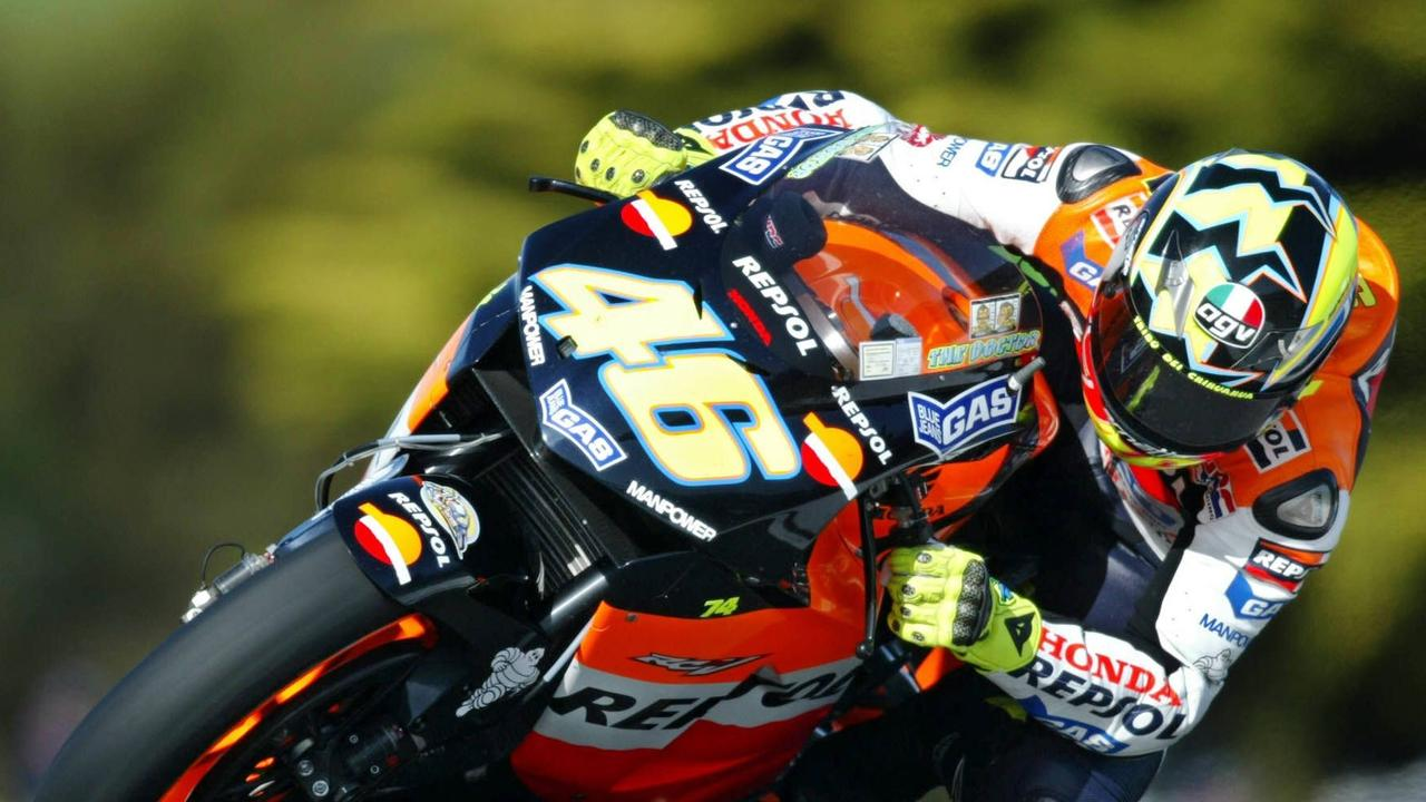 Valentino Rossi in his first championship-winning year. What year was it?