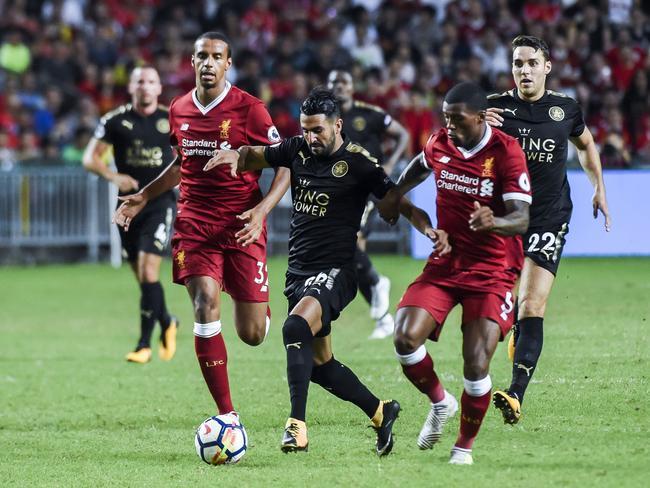 Riyad Mahrez (C) in action against Liverpool.