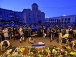 People gather to mourn and lay flowers and light candles in front of the Embassy of the Netherlands in Kiev, to commemorate passengers of Malaysian Airlines flight MH17. Picture: AFP