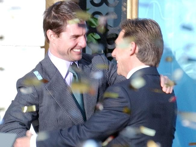 Confetti rains down as actor Tom Cruise embraces David Miscavige, the Scienology Church's President of the Ruling Council during the official opening of a new Scientology church in central Madrid in 2004.