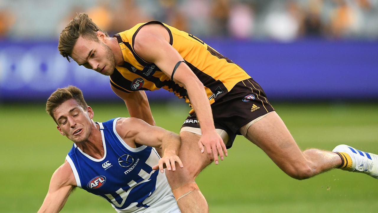 Jack Scrimshaw competes with Shaun Atley for a ball at the MCG.