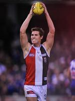 Hayes celebrates on the siren after a close win against the Bulldogs.