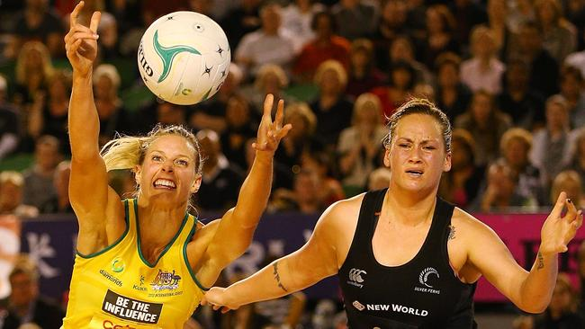 The Diamonds' Laura Geitz competes for the ball against Catherine Latu of the Silver Ferns in 2013.