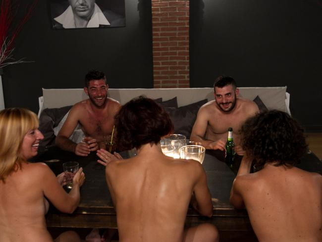 Just a casual dinner with your mates ... completely nude. Picture: Valeria Abis