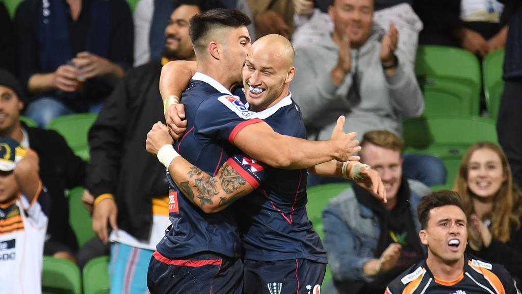 """7ef5a50c2 Rebels players Jack Maddocks (left) and Billy Meakes celebrate after  Maddocks scored against the Brumbies on Friday night. Picture  AAP. """""""