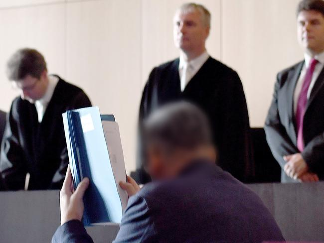 Roque M sits at in the courtroom on the start of his trial in Dusseldorf.
