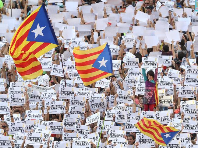 Protesters hold up signs to demand the release of imprisoned Catalan leaders Jordi Sanchez and Jordi Cuixart at a demonstration for Catalan independence in Barcelona. Picture: Getty