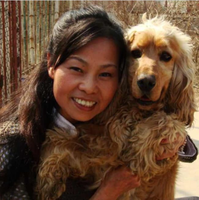 Du Yufeng, from the Bo Ai Animal Protection Centre with her pet dog.