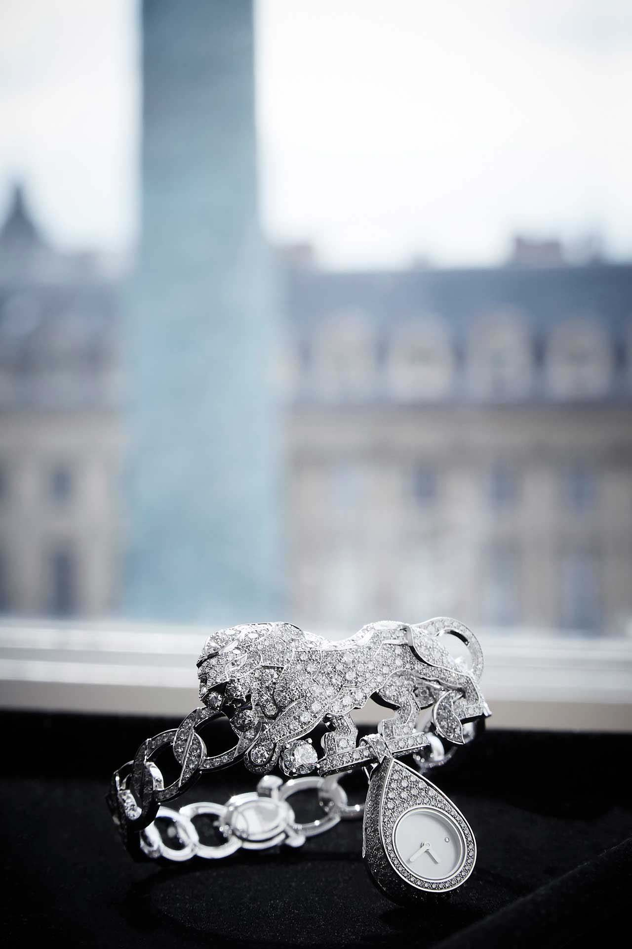 "A watch from Chanel's ""l'Esprit du Lion"" collection, with the Place Vendôme in the background. Image credit: Chanel"
