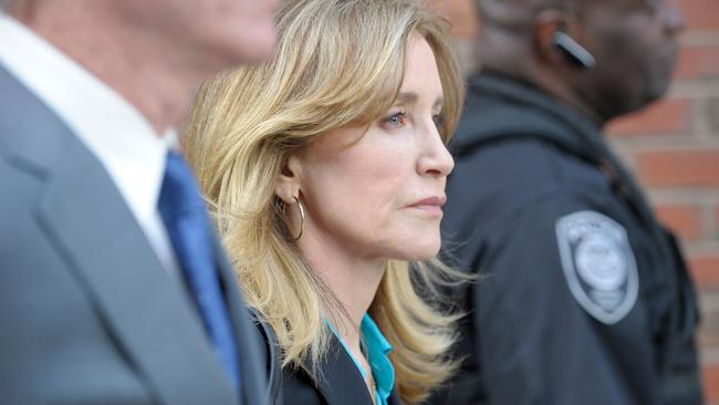 Actress Felicity Huffman exits the courthouse after facing charges for allegedly conspiring to commit mail fraud and other charges in the college admissions scandal at the John Joseph Moakley United States Courthouse in Boston on April 3, 2019. Picture: Joseph Prezioso / AFP.