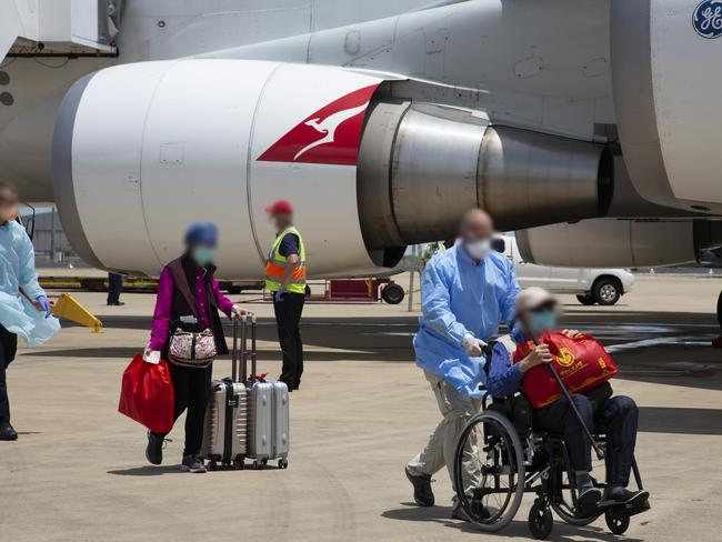 Passengers on a Qantas flight from the coronavirus-affected Chinese city of Wuhan arrive at Darwin Airport on Sunday. Picture: Department of Home Affairs