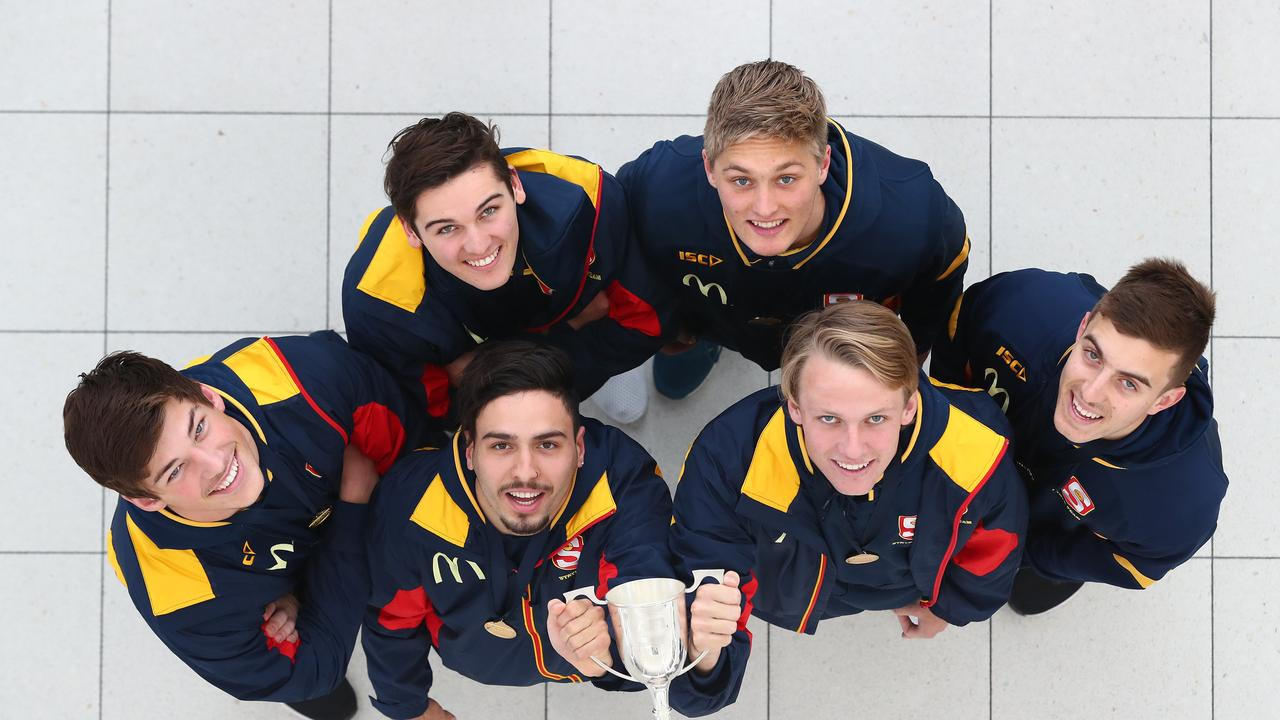 South Australia's top draft prospects holding the national championship trophy. Photo: Tait Schmaal.