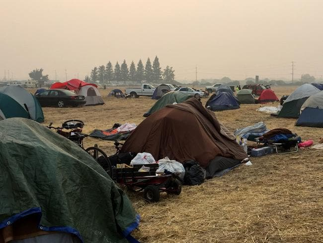 Fire evacuees camp at a parking lot after the deadliest wildfires in California's recent history. Picture: AFP