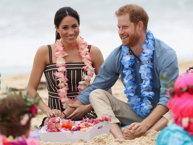 Prince Harry and wife Meghan attended a charity event at Bondi Beach as part of 2018's 16-day tour visiting cities in Australia, Fiji, Tonga and New Zealand. Picture: Chris Jackson-Pool/Getty Images