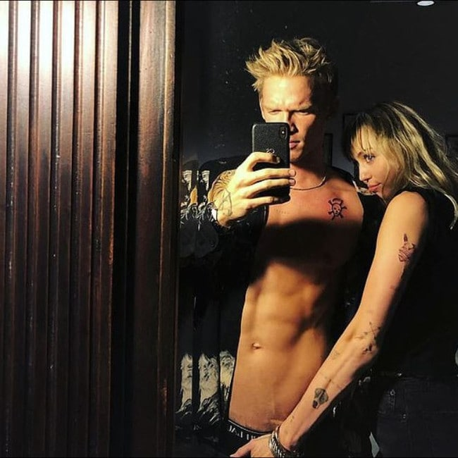 Simpson and Cyrus share a racy selfie.