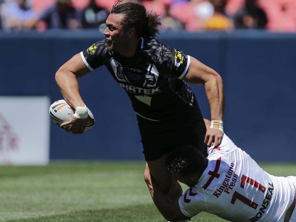 New Zealand's Raymond Faitala-Mariner, top, passes before being tackled by England's Sam Burgess (11) during the first half of a Test rugby match Saturday, June 23, 2018, in Denver. (AP Photo/Jack Dempsey)