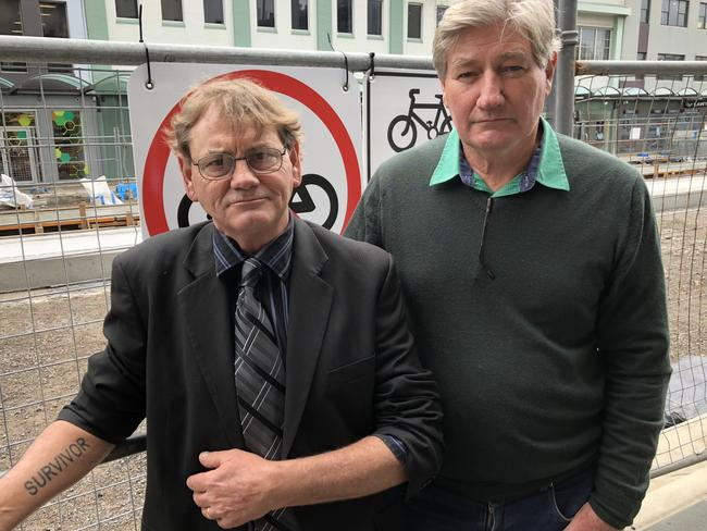 "Child sex abuse survivors and advocates Gerard McDonald (left with ""SURVIVOR"" tattoo) and Paul Gray."