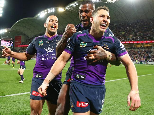 Billy Slater celebrates with Suliasi Vunivalu and Will Chambers after a prelim final try vs Brisbane.